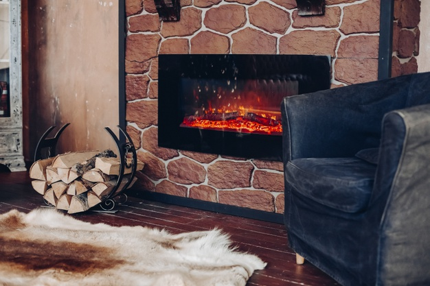 view-fireplace-with-burning-logs-natural-fur-skin-floor-holder-with-logs-cozy-room_132075-6163