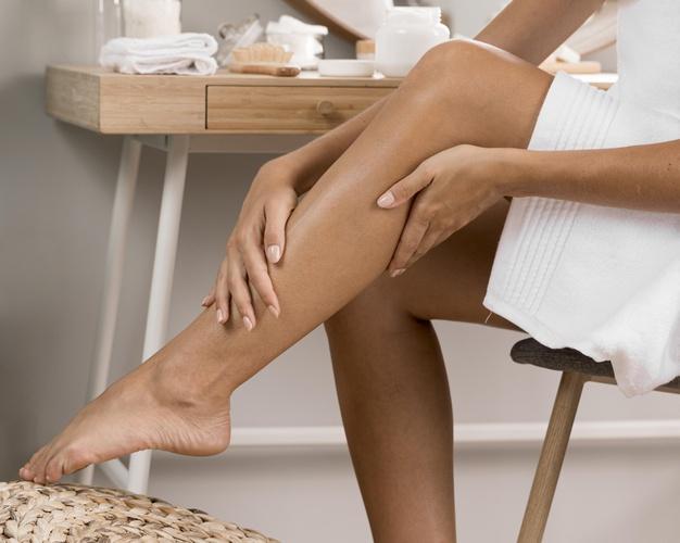 woman-s-legs-with-cream_23-2148752463